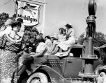 1937 Battle of Flowers parade-watchers at Mobilgas service station